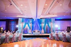gorgeous blue and silver decor and wedding stage from http://partylandflowers.com in the DC area