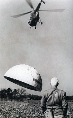 Marine Helicopter lifting a Skybreak Carolina Corp. Dome designed by Duncan Stuart and TC Howard, built in Jim Fitzgibbon's backyard in Raleigh Jan 28, 1954.  Buckminster Fuller is in the foreground watching, but he did not design the geodesic dome.