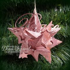 This is my sample for the 3D Star Ornament tutorial - you can find all the instructions [url=http://www.splitcoaststampers.com/resources/tutorials/3dstarornament]HERE![/url]  More details, closeups and links on my blog [url=http://mamadinis.blogspot.com/2015/12/splitcoast-tutorial-3d-star-ornament.html]HERE.[/url]   Wendy's sample is done in silver tones and I wanted to do something different, so I went with copper.  The second largest star was cut from a gel print that was mostly black and…