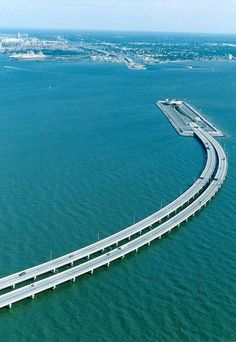 Unique bridge between Sweden and Denmark goes underwater and becomes a tunnel to allow ship passage.