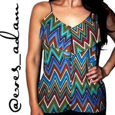 """Chevron Print Tank - Francesca's Collections Brand new with original tags! You'll be ready for the spring and summer heat in the Riviera Maya Chevron Tank! This colorful chevron print covers this spaghetti strap tank with a front ruffle around the neckline. Pair with denim shorts and strappy sandals for a complete look. Made of 100% polyester. 27"""" length, 34"""" chest.  Made in the USA. Francesca's Collections Tops Tank Tops"""