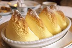 Salzburger Nockerl is an extraordinary creation that looks like the mountains near Salzburg, Austria, with big white peaks of meringue sitting on a bed of butter and grape jelly. German Desserts, Köstliche Desserts, Deutsche Desserts, Baked Meringue, Austrian Recipes, Austrian Food, Sweet Dumplings, Cookies Et Biscuits, International Recipes
