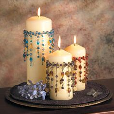 Beaded candles - very boho - inspiration only - would probably apply these to the glass, since dripping wax would ruin a lot of work otherwise! Make collars, pin to candles, to burn, put rubber band around candle jar Flameless Candles, Candle Lanterns, Diy Candles, Pillar Candles, Candle Jars, Candle Holders, Decorating Candles, Candle Decorations, Christmas Crafts
