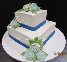 Two tierd square cake with blue band and tiny white dots and pale blue sprayed roses Traditional Wedding Cakes, Square Cakes, Blue Band, Roses, Desserts, Food, Tailgate Desserts, Deserts, Pink