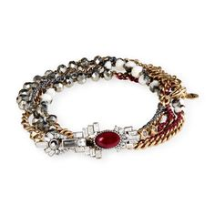 Café Society Multi-Wrap Bracelet  Wrap up your look with one of our most iconic + bestselling designs — now updated with semi-precious marbled stones, an Art Deco casting, + the warm gold + red hues of the season.  semi-precious marbled black + white stone, red goldstone resin, black diamond, hematite + clear crystal, burgundy thread