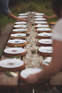 Rustic table inspiration. Wood chargers with simple white plates and clear drinkware.