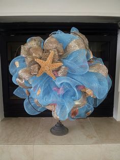 Beautiful sea blue, gold, Starfish & sea Shell deco mesh wreath was on Adoorable Cute Creations Facebook page
