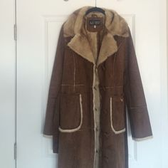 Armani Jeans faux fur Long coat In perfect condition - like new !!! Worn just once. Super warm and cozy long coat. With pockets and belt, comes also with extra buttons. Armani Jeans Jackets & Coats
