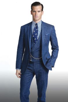 A three-piece denim suit from Ralph Lauren's Purple Label spring 2015 collection. [Photo by John Aquino]