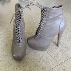 Bakers lace up booties Beige-gray lace up booties purchased at Bakers, size 7. Super cute, only worn once or twice, small cuff on the toe (see pictures). Bakers Shoes Lace Up Boots