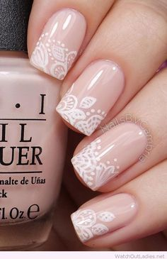 Nude nails with white lace design