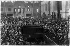 Crowd gathered around exit at Pennsylvania Station in New York City awaiting the arrival of Billy Sunday. 1917.
