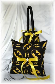 Great addition to your Batman themed wedding...... Items are done in Batman logo themed cotton print fabric, decorated with a Yellow ribbon bow with a crystal center.   ring pillow is 8