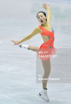 TOKYO, JAPAN - APRIL 11: Mao Asada of Japan competes in the ladies's short program during day one of the ISU World Team Trophy at Yoyogi National Gymnasium on April 11, 2013 in Tokyo, Japan.