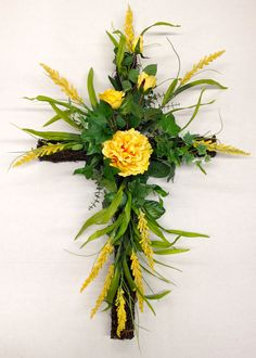 Spring 2014 Season Memorial Grape Vine Cross with Yellow Long-Stem Roses, Peony  and Wild Powdery Yellow flowering plumes. Design and arrangement by http://nfmdesign.synthasite.com