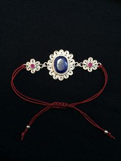 Handmade silver filigree cuff with sapphire and ruby