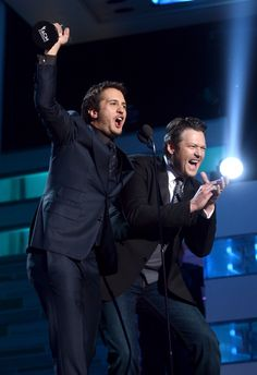 He's so excited he just can't hide it. Luke Bryan celebrates his win for Entertainer of the Year with Blake Shelton at the 48th Annual Academy Of Country Music Awards on April 7 in Las Vegas