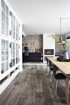 Sea of Girasoles: Interior: a touch of yellow. living room. dining room. home decor and interior decorating ideas. exposed brick wall.