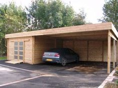 Modern detached carport with an enclosed storage area that has heating and AC.