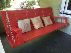 An upcycled porch swing. Created with a vintage door and reclaimed lumber and spindles from an old rocking chair. #reclaimed #porch swing
