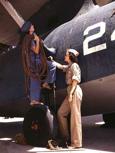 Rare color photos: Women at work in the 1940s Mrs. Cora Ann Bowen (left) works as a cowler at Naval Air Base