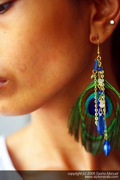 Nice way to dress up a pair of simple peacock feather earrings.