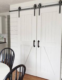 The Barn Door Hardware Store a double sliding barn door hardware kit with 8' track as well as many other barn door hardware options.