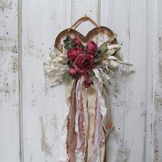 Shabby chic tattered heart wall hanging deep pink and wine roses, ribbon ,lace and torn fabric  Anita Spero