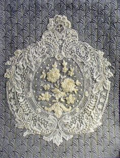 Beautiful lace piece with silk ribbon flowers. This was hand beaded to quilted background.  Cindy Needham!