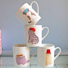 Cats & Hats MugsHumourous new tea or coffee mugs in a choice of four designs featuring cats wearing and playing with hats. Illustrated by British artist Jo Clark, these mugs are white inside and out, feel lovely and sturdy and will hold a large cup of your favourite hot drink. A purr-fect gift for any cat loverCeramic. Dishwasher and microwave safe. Vegan friendly.10.5 x 9 x 13cm
