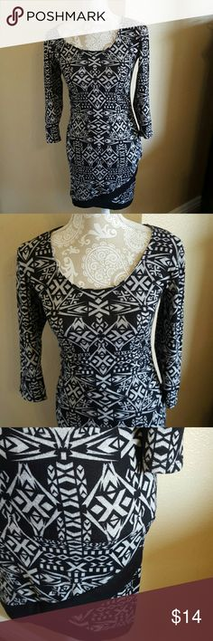 NWOT Sexy Body Con Derek Heart Dress size M NWOT Never Worn Sexy Body Con Derek Heart Aztec Design Dress size M Although does run small fits more like a Small Gray and Black. Cute faux wrap detail at bottom of dress. 3/4 sleeves and ruching down the sides. Very comfy, soft, and stretchy. 95%Polyester 5% Spandex  light weight sweater feel. Never worn excellent condition Derek Heart Dresses Asymmetrical