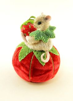 "I ❤ pincushions . OOAK 2013 Janie Comito Miniature Mouse-kin Tomato Pin Cushion & Strawberry- Mousekin is wire armatured with three way jointed head & arms, & stuffed with wool. His fur is softly hand detailed (tinted). The tail & ears are ultra suede; his eyes are black onyx beads.  He sits 1 1/2"" tall. The red velvet pin cushion measures 2 1/2"" wide x 2"" tall. A tiny red, vintage opaque glass button was sewn for connecting the red velvet strawberry emery that measures 1"" long. ~By jraggedybear"