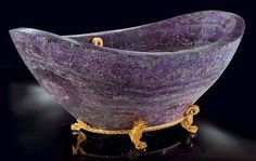 Amethyst bathtub: this is ridiculous, but it's also pretty... No one needs a bathtub made of amethyst, but hey it's nice to look at