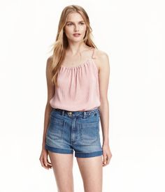 Powder pink. Flared, pleated camisole top in jersey with a sheen. Narrow, tasseled straps with ties at shoulders.