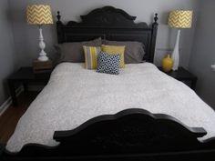 Yellow & grey Bedroom-love the black headboard and footboard.