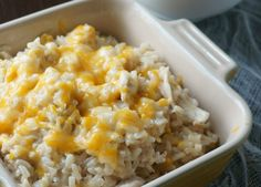 Creamy and Cheesy Chicken and Rice Wholesome brown rice, cooked chicken, and lots of cheese all swimming in a decadent, yet healthier sauce.