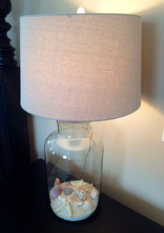 Fillable lamp...lamp from homegoods, sand and starfish from Michael's.