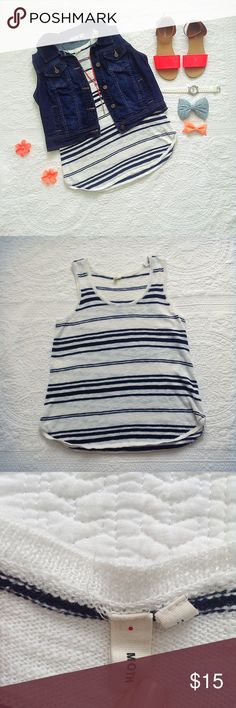 Anthropologie Moth Striped Tank White and navy striped Moth tank from Anthroplogie! I love the minimalistic style of this tank.It gives me options to dress it up or to wear as is. My favorite thing about this shirt is the breathable fabric. Great for warm weather and a trip to the beach! Interested in the Shoes? Checkout the listing in my closet! Anthropologie Tops Tank Tops