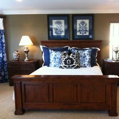 Master Bedroom....beautiful bed...and I love the navy