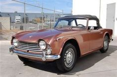 For a few years, Darcy and I drove a TR 4 much like this one.  It was a lot of fun but took a lot of work to keep it going.