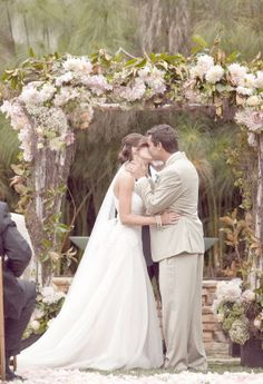 Rustic Wedding Arch decorated very generously