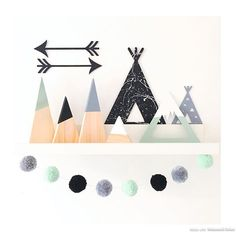 Been having a play with some possible new products i always seem to do girls things so heres something for the boys #pompomgarland #scandi #shelfie #teepee #mountains #mintgreen #black #grey #white #arrows #workinprogress #newitem