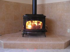 Would live to redo my stove like this. Freestanding Wood Burning Stove - Wall protection and hearth.