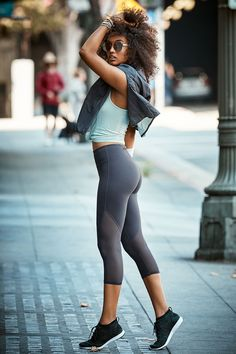 Dominate your fitness drills with a move-easy, seamless tank and moisture-wicking, mesh-paneled yoga capris. | Fabletics Jillian Outfit