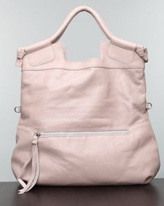 Foley + Corinna Mid City - Not in this color, but the canvas with leather trim. I have been looking for this bag for 2 years!