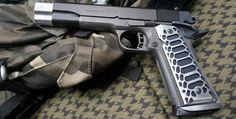 """Valkyrie Dynamics manufactures aluminum grips for 1911-style pistols, Beretta FS 92 and SIG P238. Their grips have either deepmachined textures or all the way cut through. The textures are mainly of honeycomb and what they call """"Cobra"""" style resembling the snake's scale pattern. They also come with various finishes and colors. Valkyrie Dynamics 1911 grips …   Read More …"""