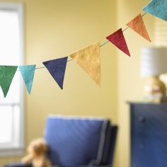 Looking for a fun way to incorporate a little extra color into your kids room? Consider this kids felt pennant garland from The Land of Nod. For more kids decor ideas visit https://www.facebook.com/KidsRoomDecor