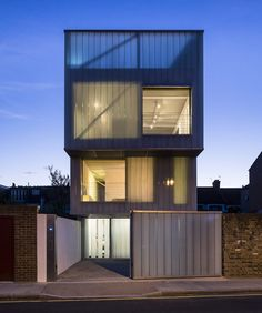 Three simple 'slipped' orthogonal box forms break up the bulk of the building and give it its striking sculptural quality. The top floor is clad in milky, translucent glass planks, which continue past the roof deck to create a high level 'sky garden'.