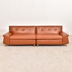 A classic mid century style with updated upholstery! Caramel leatherette for you to sink into Each Piece: x x seat height Tog. Faux Leather Sofa, Mid Century Style, Vegan Leather, Sofas, Upholstery, Couch, Furniture, Vintage, Design