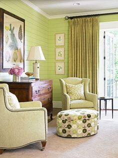 A pair of armchairs with a green hue and an ottoman covered in a velvet pattern create a lively sitting area. - Traditional Home ®/ Photo: Emily Followill / Design: June Price